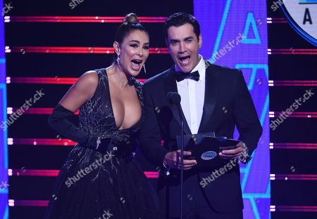 David Zepeda, Ninel Conde. David Zepeda, right, and Ninel Conde present the new artist of the year award at the Latin American Music Awards, at the Dolby Theatre in Los Angeles