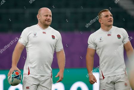 England's Dan Cole, left, and Sam Underhill attend a training session in Oita, Japan, . England will face Australia in the quarterfinals at the Rugby World Cup on Oct. 19