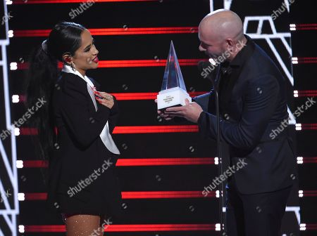 Pitbull, Becky G. Pitbull, right, presents the extraordinary evolution award to Becky G at the Latin American Music Awards, at the Dolby Theatre in Los Angeles