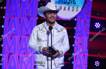 """Christian Nodal accepts the award for favorite regional mexican song for """"No Te Contaron Mal"""" at the Latin American Music Awards, at the Dolby Theatre in Los Angeles"""