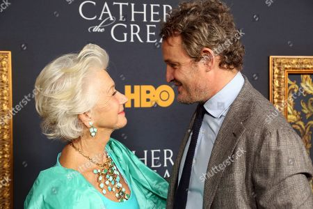 "Helen Mirren, Jason Clarke. Helen Mirren, left, and Jason Clarke look at each other as they arrive at the LA Premiere of ""Catherine the Great"" at the Hammer Museum, in Los Angeles"