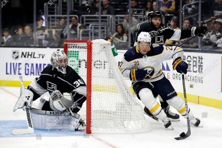 Kyle Okposo, Jack Campbell. Buffalo Sabres' Kyle Okposo (21) tries to get around Los Angeles Kings goaltender Jack Campbell during the third period of an NHL hockey game, in Los Angeles