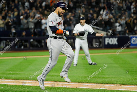 Houston Astros' Robinson Chirinos, left, reacts after flying out as New York Yankees starting pitcher James Paxton celebrates during the sixth inning in Game 5 of baseball's American League Championship Series, in New York