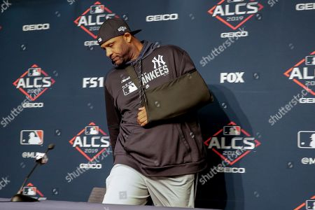 New York Yankees pitcher CC Sabathia arrives at a news conference to answer questions before Game 5 of baseball's American League Championship Series against the Houston Astros, in New York