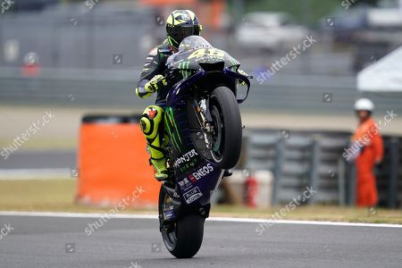 Italian MotoGP rider Valentino Rossi of Monster Energy Yamaha MotoGP Team performs a wheelie during a free practice session for the MotoGP Motorcycle Grand Prix of Japan at Twin Ring Motegi in Motegi, Tochigi Prefecture, north of Tokyo, Japan, 18 October 2019.Â