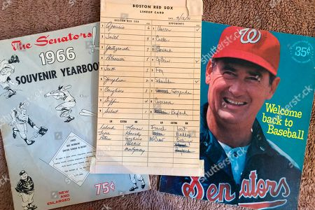 Washington Senators memorabilia including the lineup card from a game between the Senators and Boston Red Sox on April 13, 1971, in Washington, and a program featuring Ted Williams, right, are shown in New York