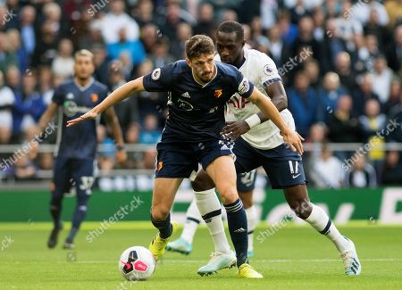 Stock Image of Craig Cathcart battles with Moussa Sissoko