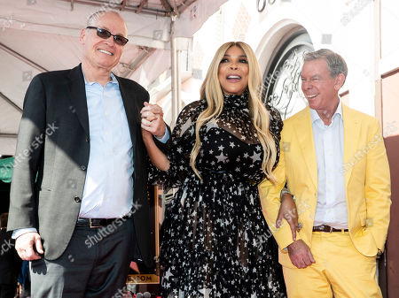 Stock Picture of US TV host Wendy Williams (C) poses for photographers while flanked by FOX television CEO Jack Abernethy (L) and radio personality Elvis Duran (R) as she attends the unveiling ceremony of her 2,677th star on the Hollywood Walk of Fame in Los Angeles, California, USA, 17 October 2019. The star was dedicated in the category of television.