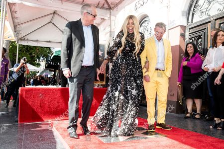 Stock Image of US TV host Wendy Williams (C) poses for photographers while flanked by FOX television CEO Jack Abernethy (L) and radio personality Elvis Duran (R) as she attends the unveiling ceremony of her 2,677th star on the Hollywood Walk of Fame in Los Angeles, California, USA, 17 October 2019. The star was dedicated in the category of television.