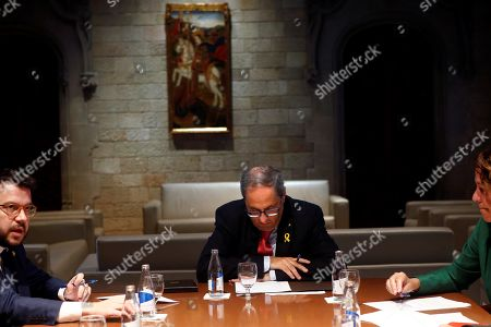 Catalonia regional President Quim Torra (C) chairs a meeting with Vice President Pere Aragones (L), Mayoress of Girona Marta Madrenas (R), Mayor of Tarragona Pau Ricoma (unseen), and Lerida Miquel Pueyo (unseen), in Barcelona, Spain, 19 October 2019. Spain witnessed an escalation of violence after the Supreme Court announced the 'process' ruling of prison terms against the Catalan political leaders accused of organizing the Catalan illegal referendum held in 2017. The Spanish Supreme Court on 14 October 2019 issued a fresh European arrest warrant for deposed former President of the Government of Catalonia, Carles Puigdemont, following its sentencing of former Catalan Vice President Oriol Junqueras to 13 years in jail for sedition and misuse of public funds. Several other political leaders were also handed prison sentences for their roles in holding a failed independence vote.