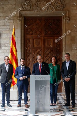 Catalonia regional President Quim Torra (C) speaks during a press conference held after a meeting with Vice President Pere Aragones (2-L), Mayoress of Girona Marta Madrenas (2-R), Mayor of Tarragona Pau Ricoma (R), and Lerida Miquel Pueyo (L), in Barcelona, Spain, 19 October 2019. Spain witnessed an escalation of violence after the Supreme Court announced the 'process' ruling of prison terms against the Catalan political leaders accused of organizing the Catalan illegal referendum held in 2017. The Spanish Supreme Court on 14 October 2019 issued a fresh European arrest warrant for deposed former President of the Government of Catalonia, Carles Puigdemont, following its sentencing of former Catalan Vice President Oriol Junqueras to 13 years in jail for sedition and misuse of public funds. Several other political leaders were also handed prison sentences for their roles in holding a failed independence vote.
