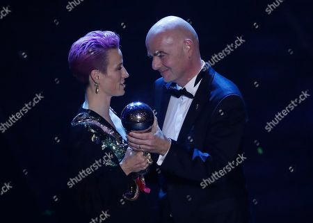 U.S. forward Megan Rapinoe, left, receives the Best FIFA Women's player award from FIFA president Gianni Infantino during the ceremony of the Best FIFA Football Awards in Milan's La Scala theater, northern Italy. Rapinoe is enjoying the whirlwind of a two-time World Cup winner. She picked up the FIFA Player of the Year award in Milan rocking a deeper shade of lavender hair, sent off retiring U.S. coach Jill Ellis with an undefeated victory tour and kept up the fight for pay equity against the U.S. Soccer Federation