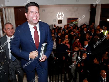 Stock Photo of Fabian Picardo (C), leader of the Gibraltar Socialist Labour Party (GSLP) and acting Chief Minister of Gibraltar, smiles after it was announced that he won the general election in Gibraltar, a British enclave in southern Spain, 18 October 2019. Picardo won the election for third time in a row after gaining the 52.5 percent of the votes.
