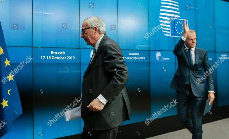President of the European Comission Jean-Claude Juncker (L) and President of the European Council, Donald Tusk leave after a press conference at the end of a European Council summit in Brussels, Belgium, 18 October 2019. This news conference is supposed to be the last one in a summit of both Presidents during their mandate.