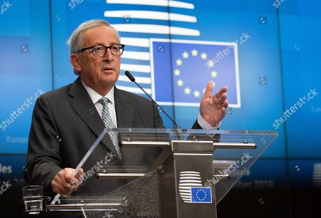 European Commission President Jean-Claude Juncker speaks during a media conference at an EU summit in Brussels, . After agreeing on terms for a new Brexit deal, European Union leaders are meeting again to discuss other thorny issues including the bloc's budget and climate change