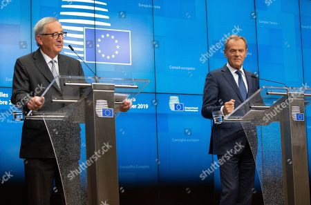 European Commission President Jean-Claude Juncker, left, and European Council President Donald Tusk participate in a media conference at an EU summit in Brussels, . After agreeing on terms for a new Brexit deal, European Union leaders are meeting again to discuss other thorny issues including the bloc's budget and climate change
