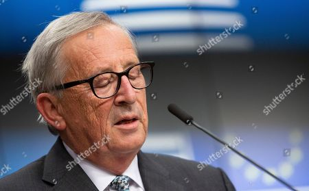 European Commission President Jean-Claude Juncker pauses before speaking during a media conference at an EU summit in Brussels, . After agreeing on terms for a new Brexit deal, European Union leaders are meeting again to discuss other thorny issues including the bloc's budget and climate change