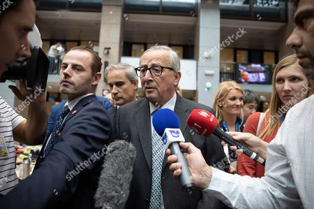 European Commission President Jean-Claude Juncker speaks to the media during an EU summit in Brussels, . After agreeing on terms for a new Brexit deal, European Union leaders are meeting again to discuss other thorny issues including the bloc's budget and climate change