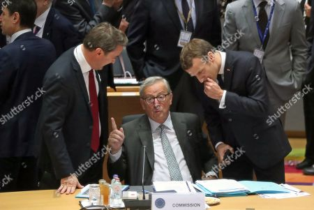 (L-R) Luxembourg's Prime Minister Xavier Bettel, European Commission President Jean-Claude Juncker and France's President Emmanuel Macron attend the second day of a EU Summit in Brussels, Belgium, 18 October 2019. The European Union (EU) and the British government have reached a tentative Brexit deal that still must be ratified.