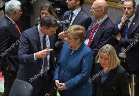 Stock Picture of (L-R) Spain's Prime Minister Pedro Sanchez (L) speaks with Germany's Chancellor Angela Merkel (C) as they attend the second day of a EU Summit in Brussels, Belgium, 18 October 2019. The European Union (EU) and the British government have reached a tentative Brexit deal that still must be ratified.