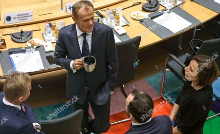 European Council President Donald Tusk (C) speaks with officials during the second day of a EU Summit in Brussels, Belgium, 18 October 2019. The European Union (EU) and the British government have reached a tentative Brexit deal that still must be ratified.
