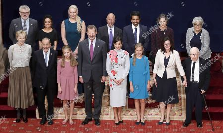 Stock Photo of Spain's King Felipe VI (4-L), Queen Letizia (4-R) and their daughters Crown Princess Leonor (3-L) and Princesss Sofia (3-R) pose for a group photo with the 2019 Princess of Asturias Awards winnersin the framework of Princess of Asturias awarding ceremony in Oviedo, northern Spain, 18 October 2019. Princess of Asturias Awards will be handed in a ceremony held at Campoamor Theater later today. (From left, front) US novelist Siri Hustvedt; President of Prado Museum's Foundation, Javier Solana; Princess Leonor; King Felipe VI; Queen Letizia; Princess Sofia; Gdansk's Mayoress, Gdansk's Mayoress Aleksandra Dulkiewicz and theater director Peter Brook. (From left, 2nd row) Prado Museum's Director Miguel Falomir; non-identified woman; US skier Lindsey Vonn; Cuban-born USsociologist Alejandro Portes; US engineer Salman Khan; Argentinian biologist Sandra Myrna Diaz and US geneticist Joanne Chory.