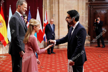 Spain's Crown Princess Leonor (2-L) gives an emblem to US engineer Salman Khan (R), winner of 2019 Princess of Asturias Award for International Cooperation, during an audience in the framework of Princess of Asturias awarding ceremony in Oviedo, northern Spain, 18 October 2019. Princess of Asturias Awards will be handed in a ceremony held at Campoamor Theater later today.