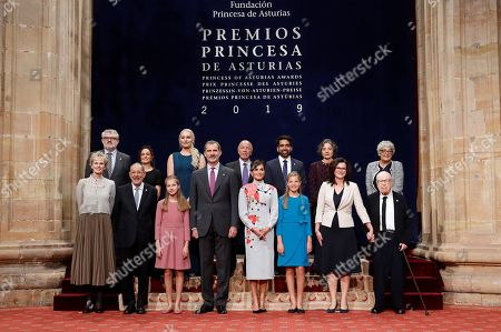 Spain's King Felipe VI (4-L), Queen Letizia (4-R) and their daughters Crown Princess Leonor (3-L) and Princesss Sofia (3-R) pose for a group photo with the 2019 Princess of Asturias Awards winnersin the framework of Princess of Asturias awarding ceremony in Oviedo, northern Spain, 18 October 2019. Princess of Asturias Awards will be handed in a ceremony held at Campoamor Theater later today. (From left, front) US novelist Siri Hustvedt; President of Prado Museum's Foundation, Javier Solana; Princess Leonor; King Felipe VI; Queen Letizia; Princess Sofia; Gdansk's Mayoress, Gdansk's Mayoress Aleksandra Dulkiewicz and theater director Peter Brook. (From left, 2nd row) Prado Museum's Director Miguel Falomir; non-identified woman; US skier Lindsey Vonn; Cuban-born USsociologist Alejandro Portes; US engineer Salman Khan; Argentinian biologist Sandra Myrna Diaz and US geneticist Joanne Chory.