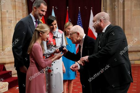 Spain's Crown Princess Leonor (2-L) gives an emblem to British playwright Peter Brook (2-R), winner of 2019 Princess of Asturias Award for Arts, during an audience in the framework of Princess of Asturias awarding ceremony in Oviedo, northern Spain, 18 October 2019. Princess of Asturias Awards will be handed in a ceremony held at Campoamor Theater later today.