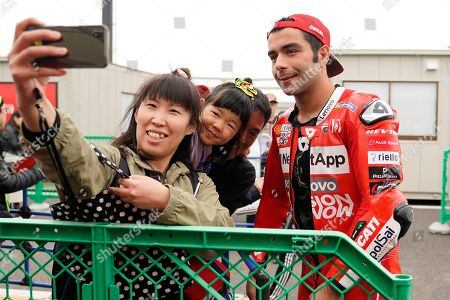 Italian MotoGP rider Danilo Petrucci of Ducati Team poses for a selfie with fans before a free practice session for MotoGP Motorcycling Grand Prix of Japan at Twin Ring Motegi in Motegi, Tochigi Prefecture, north of Tokyo, Japan, 18 October 2019.