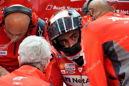 Italian MotoGP rider Danilo Petrucci of Ducati Team talks with his team staff during a free practice session for MotoGP Motorcycling Grand Prix of Japan at Twin Ring Motegi in Motegi, Tochigi Prefecture, north of Tokyo, Japan, 18 October 2019.
