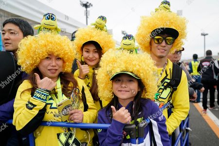 Fans of Italian MotoGP rider Valentino Rossi of Monster Energy Yamaha MotoGP Team pose for a photo in the paddock area before a free practice session for Motorcycling Grand Prix of Japan at Twin Ring Motegi in Motegi, Tochigi Prefecture, north of Tokyo, Japan, 18 October 2019.