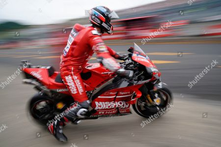 Italian MotoGP rider Danilo Petrucci of Ducati Team pits out during a free practice session for MotoGP Motorcycling Grand Prix of Japan at Twin Ring Motegi in Motegi, Tochigi Prefecture, north of Tokyo, Japan, 18 October 2019.