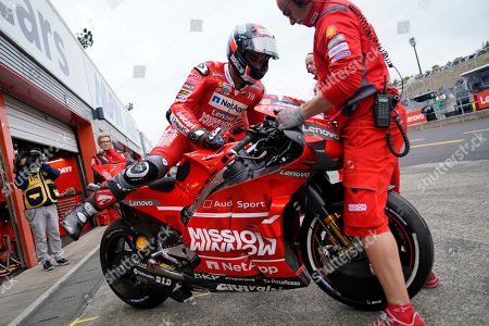 Italian MotoGP rider Danilo Petrucci of Ducati Team rides on his motorbike to pit out during a free practice session for MotoGP Motorcycling Grand Prix of Japan at Twin Ring Motegi in Motegi, Tochigi Prefecture, north of Tokyo, Japan, 18 October 2019.