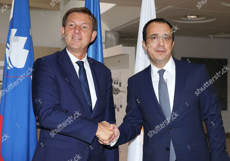 Cypriot Foreign Minister Nikos Christodoulides (R) welcomes his Slovenian counterpart Miro Cerar (L) during their meeting at the Ministry of Foreign Affairs in Nicosia, Cyprus, 18 October 2019.