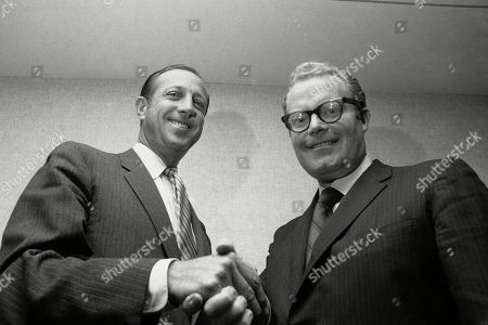 Pete Rozelle, Roone Arledge. NFL Commissioner Pete Rozelle, left, and Roone Arledge, president of ABC Sports, shake hands in New York, where it was announced that ABC would televise 13 regular-season games on Monday nights