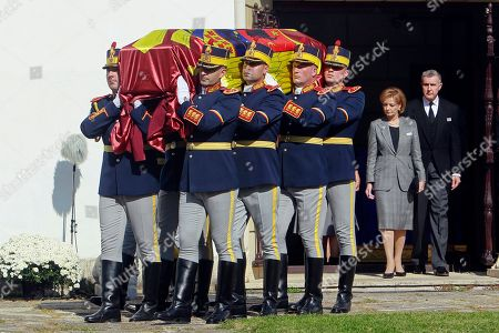 Stock Image of Honour guard soldiers carry the coffin with the remains of Queen Mother Helen of Romania, born Helen of Greece and Denmark, followed by Princess Margareta of Romania, Custodian of the Crown of Romania, and her husband Radu Duda while leaving Elisabeta palace in Bucharest, Romania, 18 October 2019. Queen Mother Helen left Romania in 1947 when her son, late King Michael, was forced to abdicate by the communist regime. Helen died in exile in Lausanne, Switzerland in1982 at the age of 86. Her remains will be reinterred alongside her son King Michael at the new Archdiocesan and Royal Cathedral in Curtea de Arges.