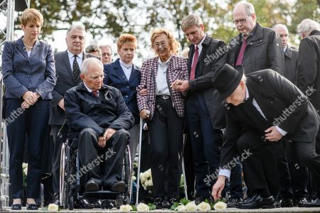 The president of the German Parliament Bundestag Wolfgang Schauble (3-L), holocaust survivor Ingeborg Geissler (born 1932) (5-L), Ambassador of Israel to Germany Jeremy Issacharoff (2-L), the vice president of the German Parliament Petra Pau (4-L) and Minister of Science, Research and Culture of Brandenburg, Martina Muench (L), put down white roses during a commemoration ceremony at the 'Gleis 17' (lit.: Track 17) memorial site in the Grunewald district of Berlin, Germany, 18 October 2019. A ceremony was held at the notorious 'Gleis 17' to commemorate the thousands of Jews who were deported from here from October 1941 on by the Nazis to the concentration and death camps 78 years ago.