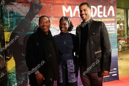 Actor Eric Lee Johnson (L), German singer Ivy Quainoo (C) and German presenter Patrice Bouedibela (R) pose during a photocall of the exhibition 'Mandela -The Official Exhbition' in Berlin, Germany, 18 October 2019. The new global touring exhibition shows Mandela's life from his struggles as a freedom fighter to becoming a political leader.