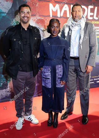 Stock Picture of The grandson of Nelson Mandela, Nkosi Zwelivelile Mandela ('Chief Mandela') (R), German singer Ivy Quainoo (C) and German presenter Patrice Bouedibela (L) pose during a photocall of the exhibition 'Mandela -The Official Exhbition' in Berlin, Germany, 18 October 2019. The new global touring exhibition shows Mandela's life from his struggles as a freedom fighter to becoming a political leader.