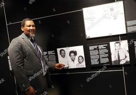 The grandson of Nelson Mandela, Nkosi Zwelivelile Mandela ('Chief Mandela') explains a family picture part of the exhibition 'Mandela: The Official Exhibition' in Berlin, Germany, 18 October 2019. The global touring exhibition shows former South African president Nelson Mandela's life from his struggles as a freedom fighter to that of a political leader.