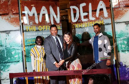 The grandson of Nelson Mandela, Nkosi Zwelivelile Mandela ('Chief Mandela') (C-L) and his wife, Rabia Clarke (C-R), cut the ribbon in the opening of the exhibition 'Mandela: The Official Exhibition' in Berlin, Germany, 18 October 2019. The global touring exhibition shows former South African president Nelson Mandela's life from his struggles as a freedom fighter to that of a political leader.