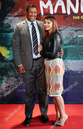 Stock Photo of The grandson of Nelson Mandela, Nkosi Zwelivelile Mandela ('Chief Mandela') and his wife, Rabia Clarke (R), pose for pictures at the opening of the exhibition 'Mandela: The Official Exhibition' in Berlin, Germany, 18 October 2019. The global touring exhibition shows former South African president Nelson Mandela's life from his struggles as a freedom fighter to that of a political leader.
