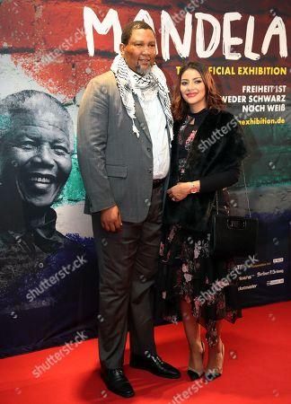 Stock Photo of The grandson of Nelson Mandela, Nkosi Zwelivelile Mandela ('Chief Mandela') (L) and his wife, Rabia Clarke (R) pose during a photocall of the exhibition 'Mandela -The Official Exhbition' in Berlin, Germany, 18 October 2019. The new global touring exhibition shows Mandela's life from his struggles as a freedom fighter to becoming a political leader.
