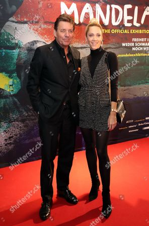 Manager Peter Wolf (L) and his wife Melanie (R) pose during a photocall of the exhibition 'Mandela -The Official Exhbition' in Berlin, Germany, 18 October 2019. The new global touring exhibition shows Mandela's life from his struggles as a freedom fighter to becoming a political leader.