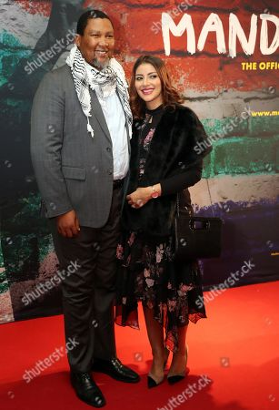 The grandson of Nelson Mandela, Nkosi Zwelivelile Mandela ('Chief Mandela') (L) and his wife, Rabia Clarke (R) pose during a photocall of the exhibition 'Mandela -The Official Exhbition' in Berlin, Germany, 18 October 2019. The new global touring exhibition shows Mandela's life from his struggles as a freedom fighter to becoming a political leader.