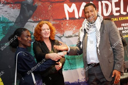 The grandson of Nelson Mandela, Nkosi Zwelivelile Mandela ('Chief Mandela') (R), German singer Ivy Quainoo (L) and artist Meike Ziegler (C) pose during a photocall of the exhibition 'Mandela -The Official Exhbition' in Berlin, Germany, 18 October 2019. The new global touring exhibition shows Mandela's life from his struggles as a freedom fighter to becoming a political leader.