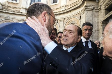 Former Italian prime minister and leader of Forza Italia party Silvio Berlusconi (R) greets former foreign minister Angelino Alfano (L) as he arrives at the funeral of his spokesman Paolo Bonaiuti, in Rome, Italy, 18 October 2019. Bonaiuti died after a long illness at the age of 79.