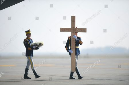 """Stock Image of Honor guard soldiers carry a cross bearing the words """"Elena The Queen"""" during the ceremony for the repatriation of the remains of Helen of Greece and Denmark, Romania's Queen Mother at the Henri Coanda Airport outside Bucharest, Romania, The remains of Romania's Queen Mother, Helen of Greece and Denmark, the mother of late King Michael I, who was awarded the Righteous Among Nations honorific by the state of Israel for her contribution to saving Jews during WWII, were returned for burial in Romania from Lausanne, Switzerland, where she passed away in 1982 at the age of 86"""