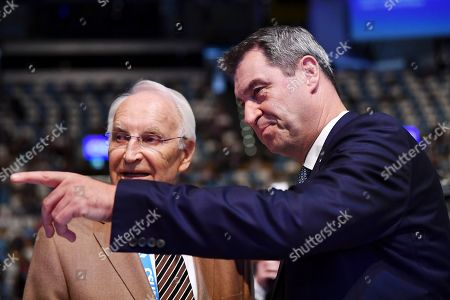 From L-R Honorary Chairman of the Christian Social Union (CSU) party, Edmund Stoiber, and Premier of Bavaria and Christian Social Union (CSU) chairman Markus Soeder speak during the Christian Social Union (CSU) party convention in Munich, Germany, 18 October 2019.. The CSU participates in the federal government together with its sister party, the Christian Democratic Party, CDU.